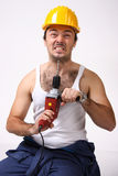 Repairman. With drill  on white Royalty Free Stock Photos