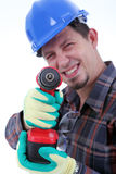 Repairman with drill, white background. Repairman with drill on the white background. Isolated on white royalty free stock photos