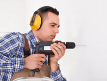 Repairman Drilling Hole In Wall Royalty Free Stock Images