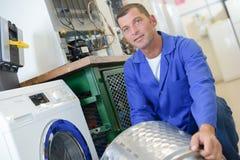 Repairman with drum washing machine Royalty Free Stock Image