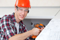Repairman with electric drill Stock Photos