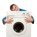 Repairman embraces washing machine Stock Photos