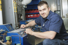 Repairman engineer. A repairman engineer or inspector who check the system Stock Image