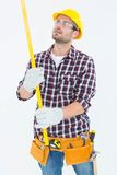 Repairman examining spirit level Royalty Free Stock Image