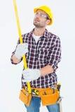 Repairman examining spirit level Royalty Free Stock Image