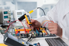 Free Repairman Fixes Electronic Equipment Stock Photography - 41590322