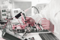 Repairman fixes electronic equipment Royalty Free Stock Photo