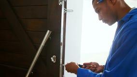 Repairman fixing cupboard stock video footage