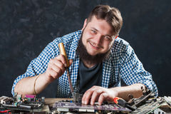 Repairman fixing problem with soldering tool Royalty Free Stock Image