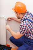 Repairman fixing radiator Stock Photos