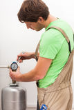 Repairman fixing valves in home royalty free stock image