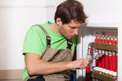 Repairman fixing valves in home Stock Photography