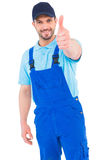 Repairman gesturing thumbs up. On white background Stock Images