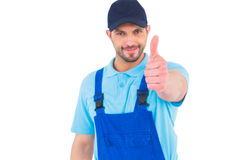 Repairman gesturing thumbs up. On white background Stock Photo