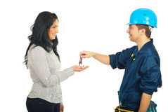 Repairman giving keys to woman Stock Photo
