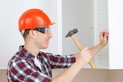 Repairman with hammer Royalty Free Stock Image