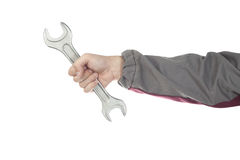 Repairman hand with wrench. Isolated on white Royalty Free Stock Images