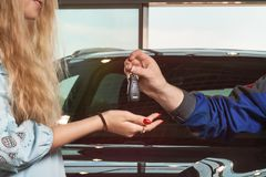 Car keys. Repairman hands over the car keys to the car service center stock photography