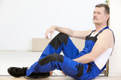 Repairman. Having a break with his eyes closed Royalty Free Stock Image