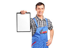A repairman holding a blank clipboard Stock Photography