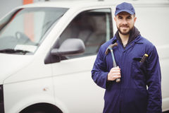 Repairman holding a hammer Royalty Free Stock Image