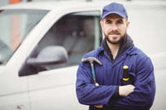 Repairman holding a hammer Royalty Free Stock Photo