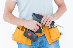Repairman holding handheld drill Stock Images