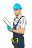Repairman holding saw Royalty Free Stock Photo
