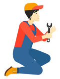 Repairman holding spanner. Stock Images