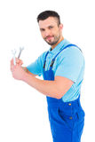 Repairman holding spanners Royalty Free Stock Images