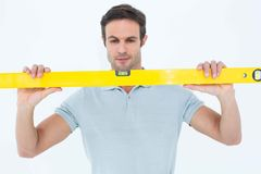 Repairman holding spirit level over white background Royalty Free Stock Photography