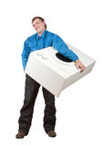 Repairman holding washing machine Royalty Free Stock Photography