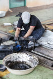 Repairman holding a wrench and tighten and during maintenance wo. Rk of the machine Stock Image