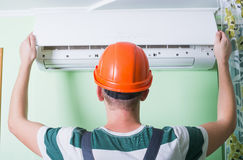 Repairman install air conditioning Royalty Free Stock Images