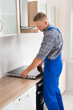 Repairman Installing Induction Cooker Stock Images