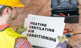 Free Repairman Is Looking At Documentation Of HVAC Stock Image - 65811591