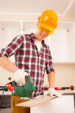 Repairman with jigsaw stock photo