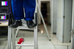 Repairman ladder. A repairman is stepping ladder repair Stock Photo