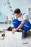 The repairman laying laminate flooring at home Royalty Free Stock Photo