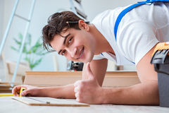 The repairman laying laminate flooring at home Stock Photo