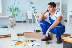 The repairman laying laminate flooring at home Royalty Free Stock Photography