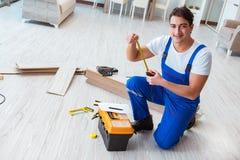 The repairman laying laminate flooring at home Royalty Free Stock Image