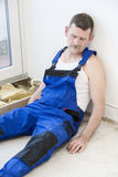 Repairman. Lying on the floor and sleeping Stock Photography