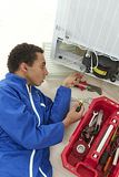 Repairman makes refrigerator appliance Stock Photos