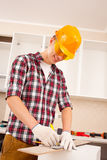 Repairman making markup stock photography