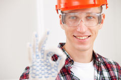 Repairman making a perfect gesture stock image