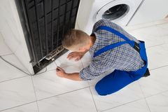 Repairman Making Refrigerator Appliance Stock Photos