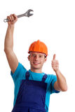 Repairman with metal wrench Royalty Free Stock Photography