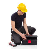Repairman opening a toolbox Royalty Free Stock Images