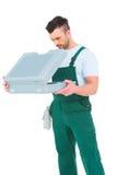 Repairman opening toolbox Stock Images